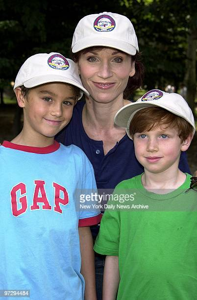 Marilu Henner is joined by her sons Michael and Joey at the Broadway Softball League AllStar and Old Timers softball game in Central Park Henner who...