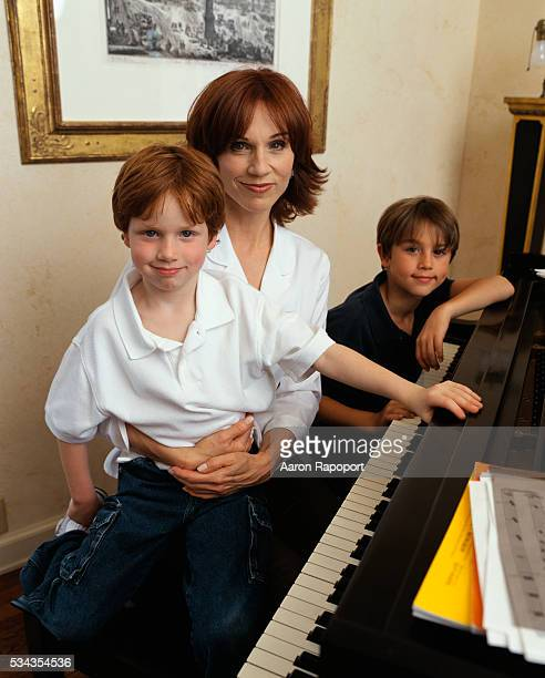 Marilu Henner sits with her sons Joseph and Nicholas