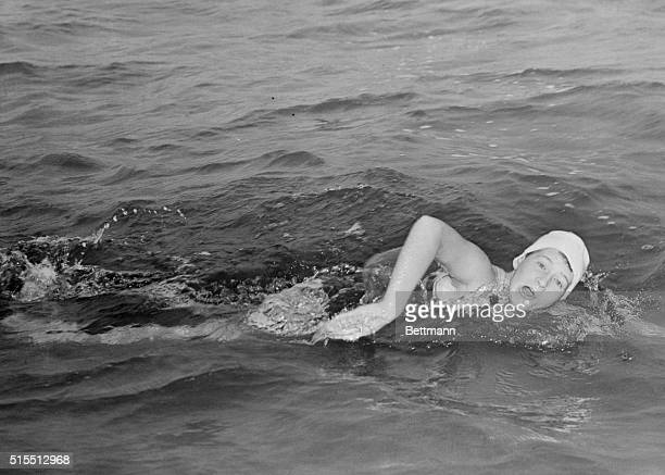 Marilyn Bell a 16yearold girl from Toronto midstroke during her attempt to swim across Lake Ontario Bell took the challenge after famous American...