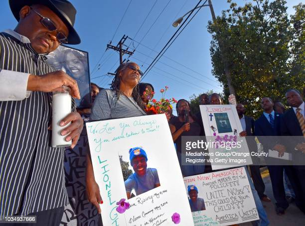 Marilyn Carter center grandmother of Lionel Gibson attends a vigil for Gibson in Long Beach CA on Wednesday May 18 2016 A couple dozen family friends...