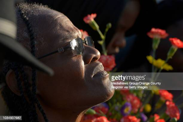 Marilyn Carter grandmother of Lionel Gibson attends a vigil for Gibson in Long Beach CA on Wednesday May 18 2016 A couple dozen family friends and...