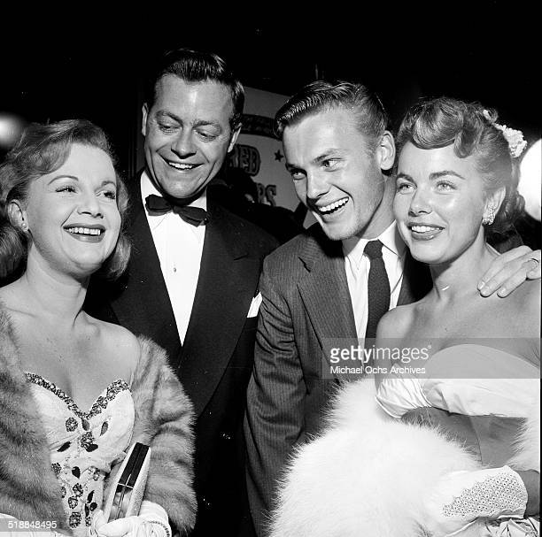 Marilyn ErskineCasey Adams Terry Moore and Tab Hunter attend a movie premiere party for Red Garters at Mocambo in Los AngelesCA