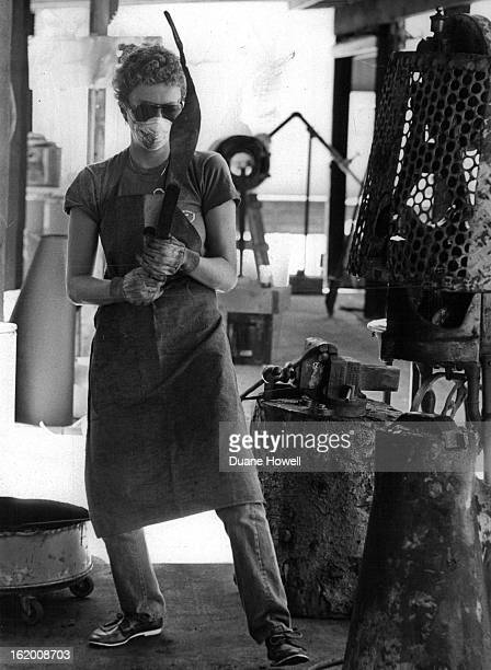 JUL 17 1980 JUL 22 1980 JUL 27 1980 Marilyn Griewank of Bowling Green Ohio inspects piece of metal front right corner after pounding it with a...