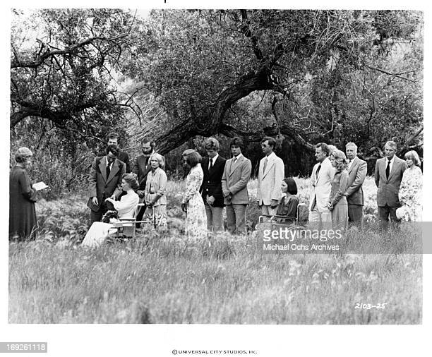 Marilyn Hassett and Timothy Bottoms attend a ceremony in a scene from the film 'The Other Side Of The Mountain Part II' 1978