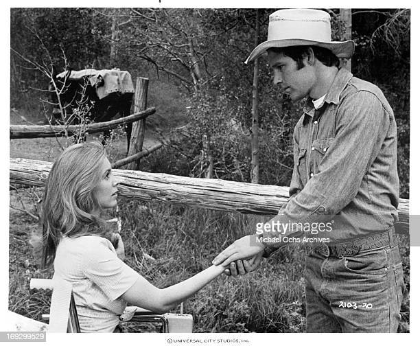 Marilyn Hassett holds hands with Timothy Bottoms in a scene from the film 'The Other Side Of The Mountain Part II' 1978