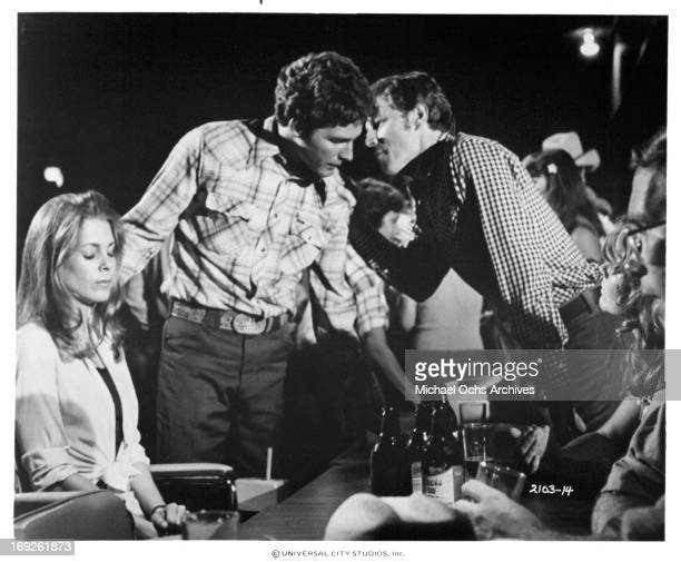 Marilyn Hassett looks on as Timothy Bottoms is approached by Curtis Credel in a scene from the film 'The Other Side Of The Mountain Part II' 1978