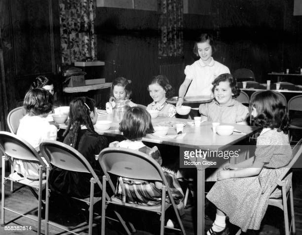Marilyn Healey serves at the Supper Club where twice a week meals are prepared and produced by the members of the Charlestown Girls' Club in Boston...