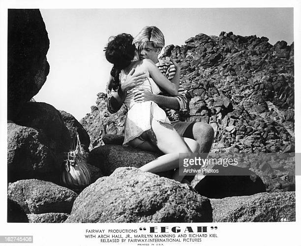 Marilyn Manning is hugged by Arch Hall Jr in a scene from the film 'Eegah' 1962