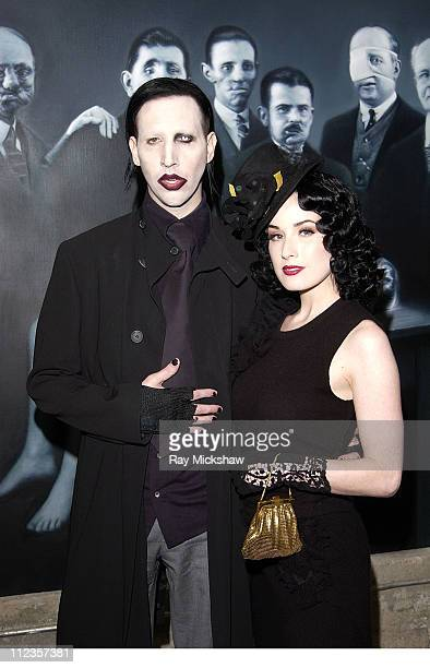 Marilyn Manson and Dita Von Teese during The Jason Lee Foundation for the Arts and Smirnoff Ice Present Gottfried Helnwein at Helnwein Studio in Los...