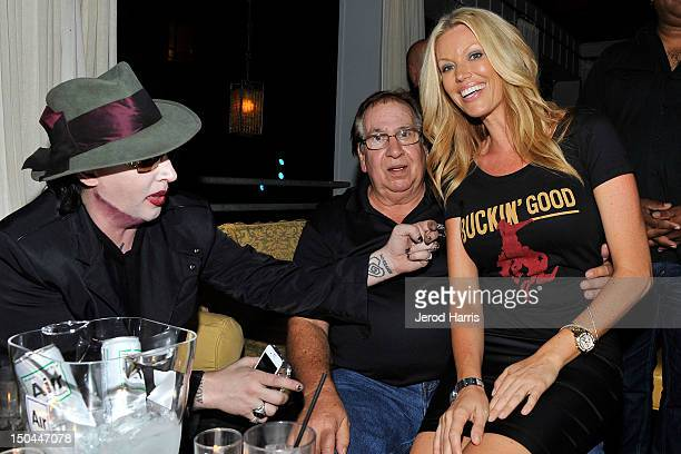 Marilyn Manson and father Hugh Warner pose for a picture with a Black Star Beer spokesmodel at the 5th Annual Sunset Strip Music Festival official...