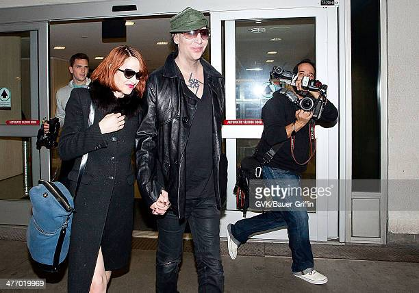 Marilyn Manson and Lindsay Usich are seen at LAX on November 14 2012 in Los Angeles California