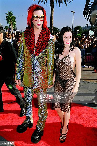 Marilyn Manson and Rose McGowan at the 1998 MTV Video Music Award Arrivals at Universal Studios in Universal City CA