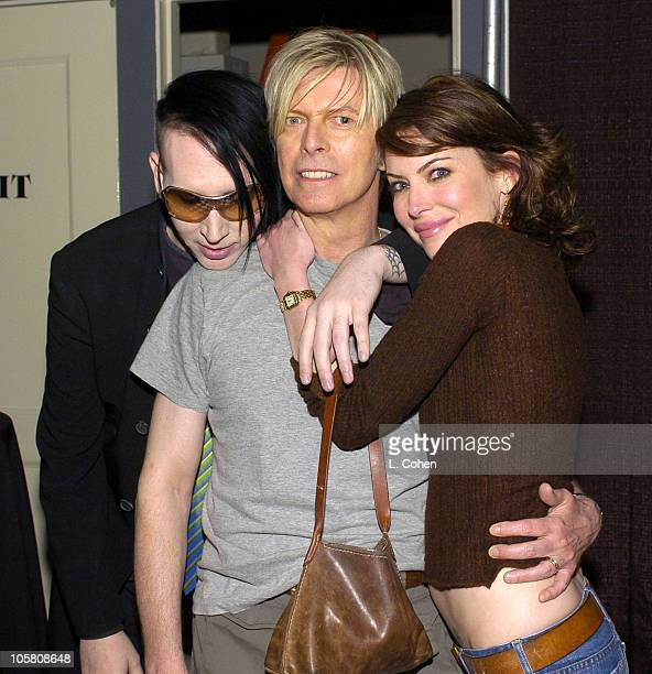 Marilyn Manson David Bowie and Lara Flynn Boyle during David Bowie's 'A Reality Tour' Backstage at Greek Theatre in Los Angeles California United...