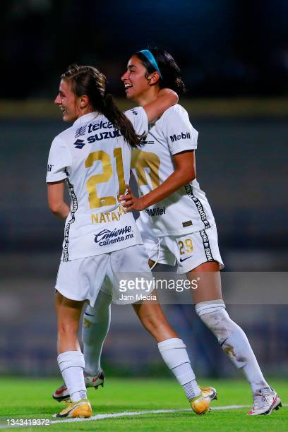 Marilyn Margoth Campa of Pumas celebrates with teammate Natalia Macias after scoring the first goal of her team during a match between Pumas and...