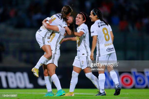 Marilyn Margoth Campa of Pumas celebrates with teammates after scoring the third goal of her team during a match between Pumas and Juarez as part of...