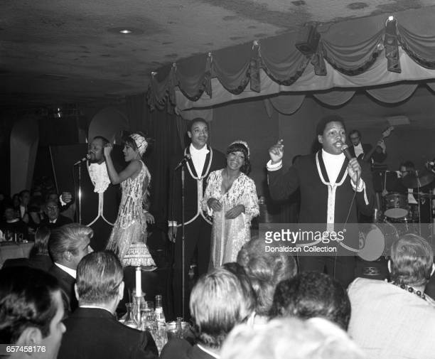 Marilyn McCoo Florence LaRue Billy Davis Jr LaMonte McLemore and Ron Townson of the vocal group 5th Dimension perform onstage at the Americana Hotel...