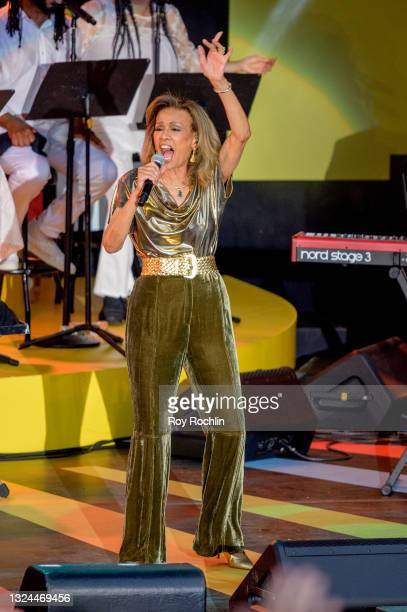 """Marilyn McCoo performs during Questlove's """"Summer Of Soul"""" screening & live concert at Marcus Garvey Park in Harlem on June 19, 2021 in New York City."""