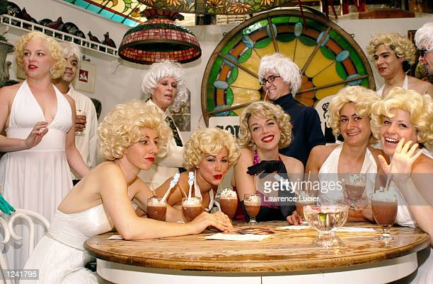 Marilyn Monroe and Andy Warhol fans appear at a lookalike contest and seance at the restaurant Serendipity August 2 2002 in New York City August 5 is...
