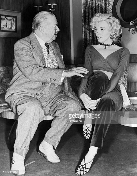 Marilyn Monroe and Charles Coburn Sitting and Talking.