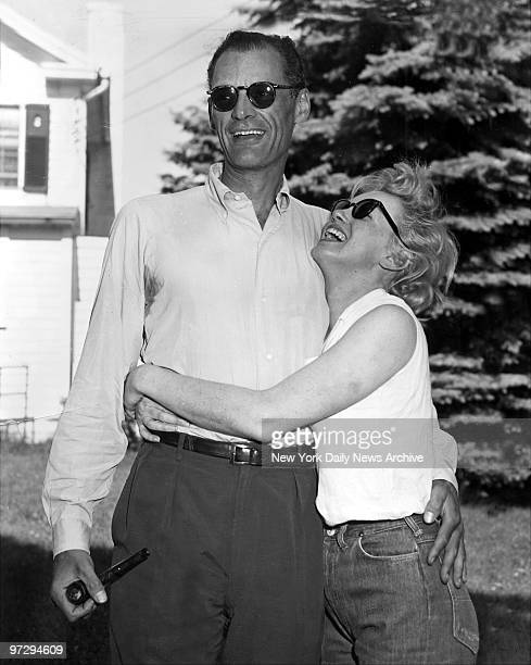 Marilyn Monroe and her fiance, Arthur Miller, on the lawn of Miller's home in Roxbury, Conn.