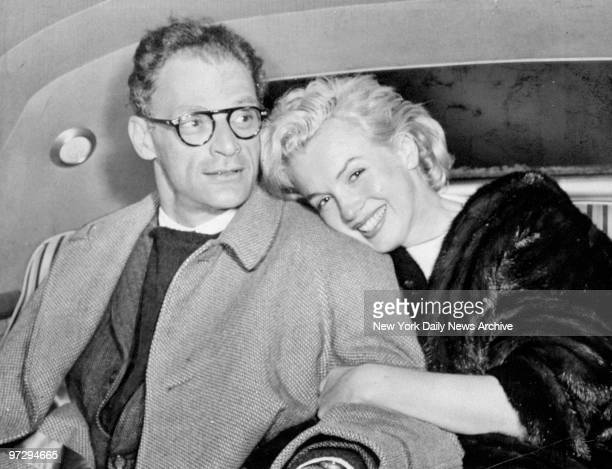 Marilyn Monroe and husband Arthur Miller in car at Idlewild Airport after arriving from Kingston Jamaica