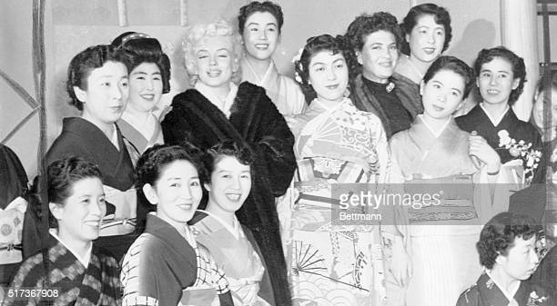 Marilyn Monroe and Jean O'Doul the wife Lefty O'Doul are shown posing with pretty Japanese Geisha Girls after a Sukiyaki Dinner in Kobe The dinner...