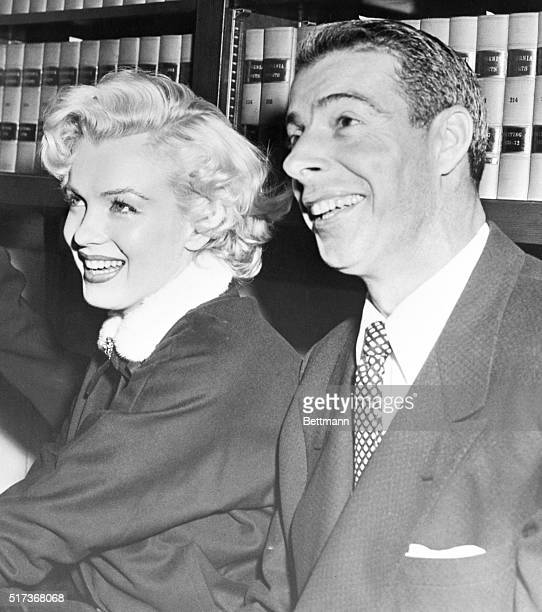 Marilyn Monroe and Joe DiMaggio in the judges' chambers just after a San Francisco judge married them