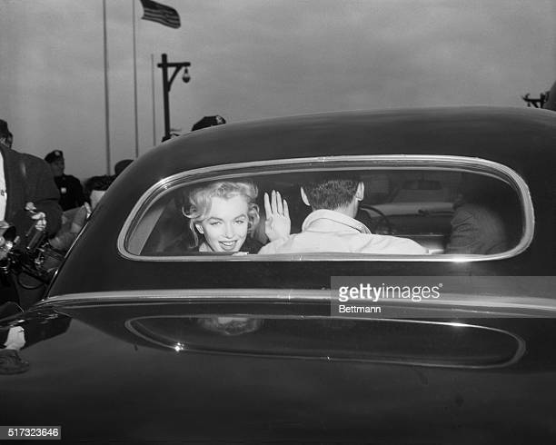 Marilyn Monroe and playwright husband Arthur Miller depart Idlewild airport after arriving from London on Pan American Airlines.