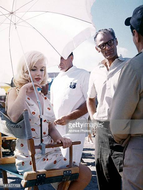 Marilyn Monroe and screenwriter Arthur Miller on set of the film 'The Misfits' 1961