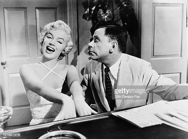 Marilyn Monroe and Tom Ewell in a scene from 'The Seven Year Itch', directed by Billy Wilder, 1955.