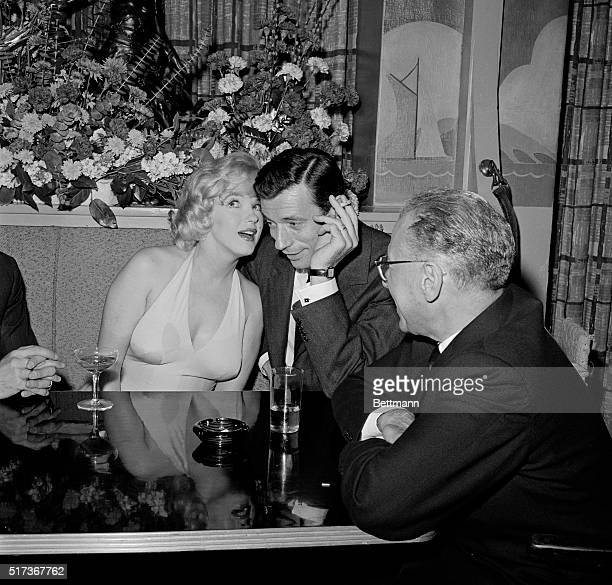 Marilyn Monroe and Yves Montand are shown at a cocktail party in January 1960 Marilyn announced here Nov 11 that she was divorcing her husband Arthur...