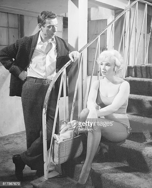 Marilyn Monroe and Yves Montand as Amanda Dell and JeanMarc Clement in the comedy Let's Make Love Released in 1960