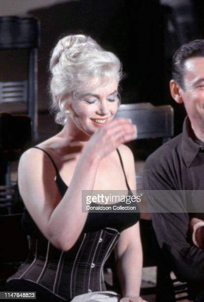 Marilyn Monroe and Yves Montand on the set of the movie Let's Make Love in 1960 in California