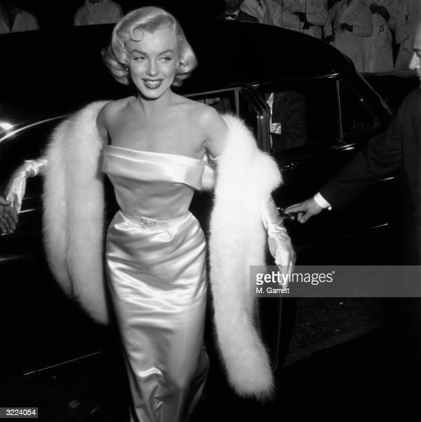 Marilyn Monroe arriving at the premiere of the film 'There's No Business like Show Business'