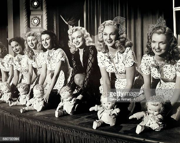 Marilyn Monroe as Peggy Martin in the musical number 'Every Baby Needs a Da Da Daddy' Beside her to the right is Adele Jergens playing Peggy's mother...