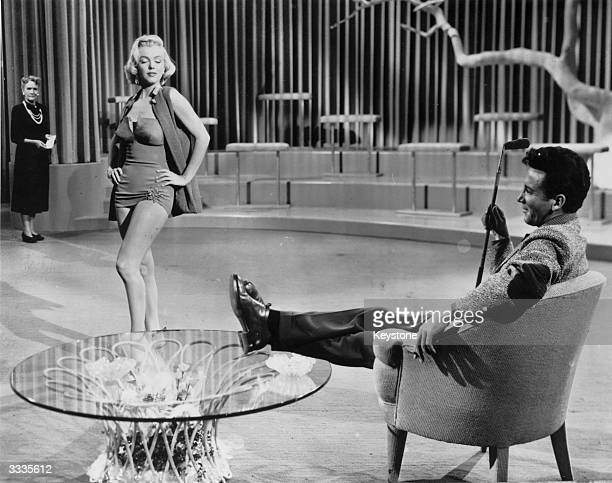 Marilyn Monroe as Pola Debevoise and Cameron Mitchell as Tom Brookman in rehearsal for the film 'How to Marry a Millionaire' directed by Jean...