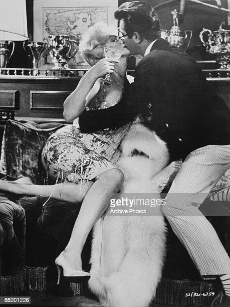 Marilyn Monroe as Sugar Kane and Tony Curtis as 'Junior' kiss in a scene from 'Some Like It Hot' directed by Billy Wilder 1959 Kane is unaware that...