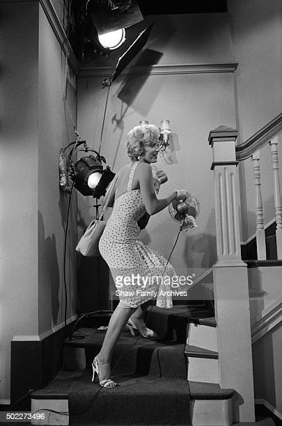 Marilyn Monroe ascends a staircase wearing a polkadot dress in 1954 during the filming of 'The Seven Year Itch' in Los Angeles California