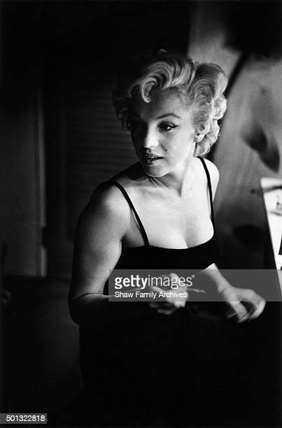 Marilyn Monroe at a makeup table getting ready for an event in 1955 in New York New York