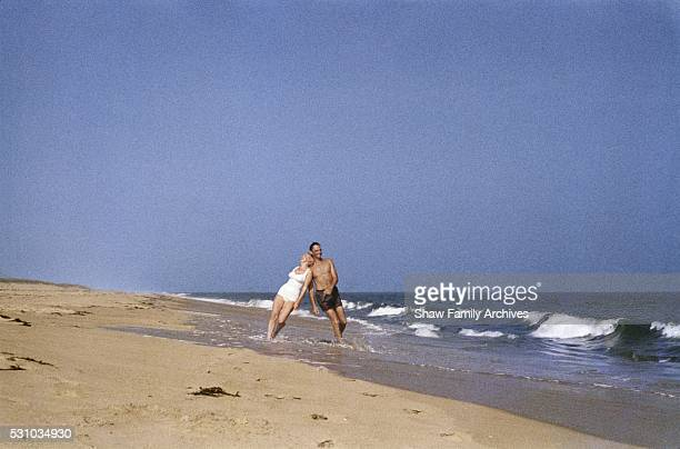 Marilyn Monroe at the beach with her husband the playwright Arthur Miller in 1957 in Amagansett New York