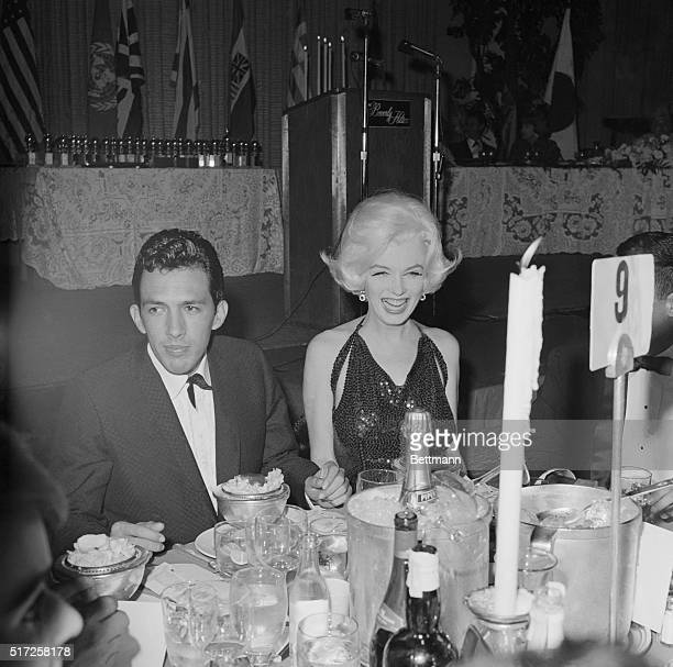 Marilyn Monroe at the Golden Globes Awards with screenwriter Jose Bolanos