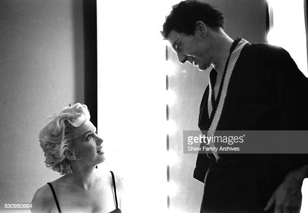Marilyn Monroe backstage at a Broadway theater visiting actor David Wayne during the run of Teahouse of the August Moon in 1954 in New York New York