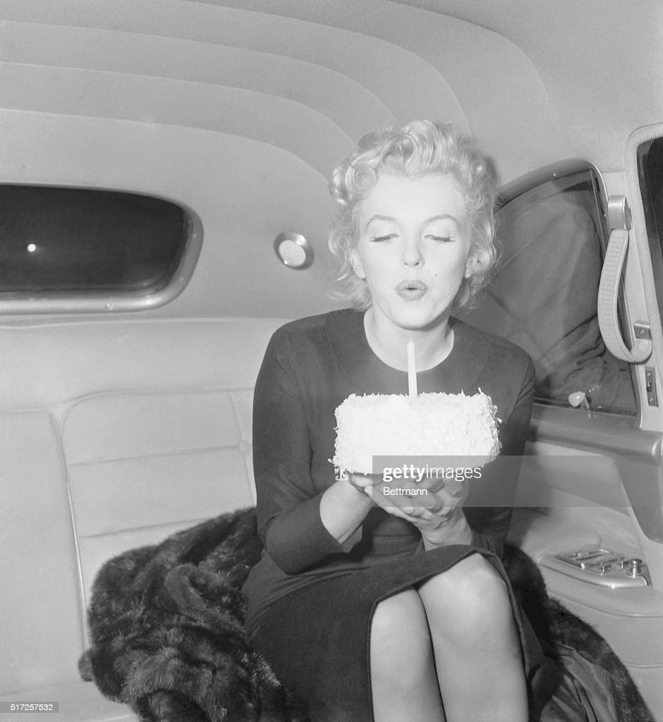 Marilyn Monroe Blowing Out Candle On 30th Birthday Cake Pictures