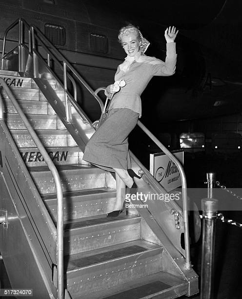 Marilyn Monroe boarding airplane waving goodbye