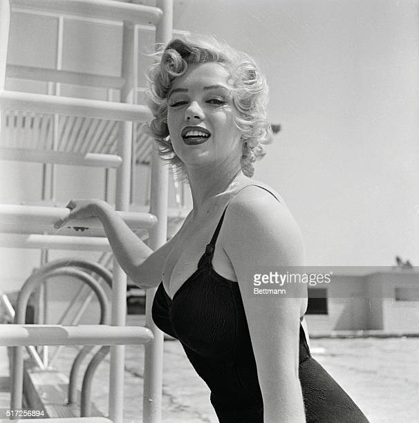 Marilyn Monroe considered for excellent and obvious reasons Hollywood's most exciting blonde since Jean Harlow looks curvy and outdoorsy as she is...