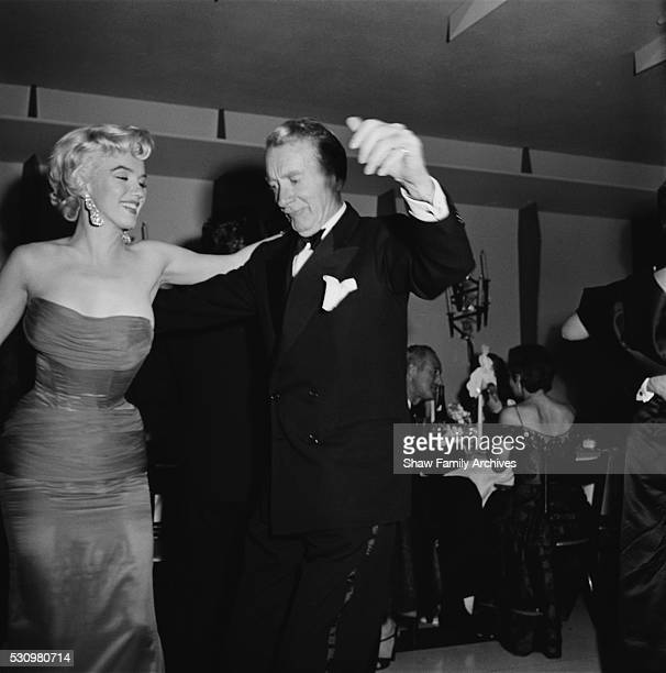Marilyn Monroe dances with actor Clifton Webb at the wrap party for the filming of The Seven Year Itch at Romanoff's Restaurant in 1954 in Los...