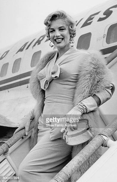 Marilyn Monroe descends the staircase of an airplane after a TWA flight from Hollywood to LaGuardia Airport in 1954 in New York New York