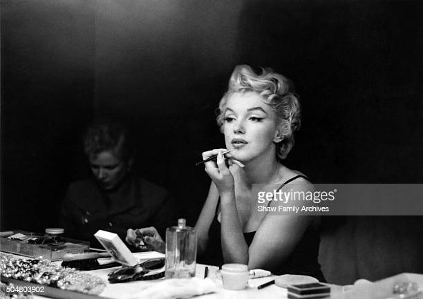Marilyn Monroe getting ready at a makeup table in 1955 in New York New York