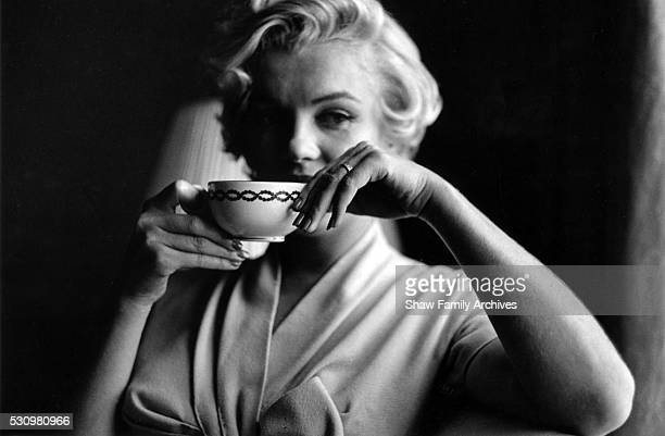 Marilyn Monroe holds a cup of tea in a room at the Hotel St Regis in 1954 in New York New York