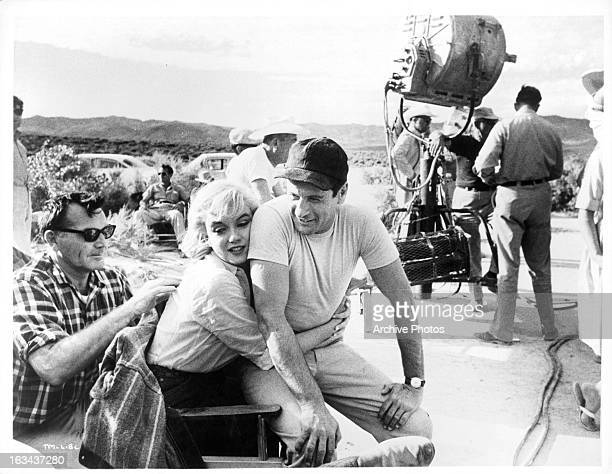 Marilyn Monroe hugging Eli Wallach on the set of the film 'The Misfits' 1961